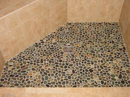 shows rounded river rocks in a shower floor