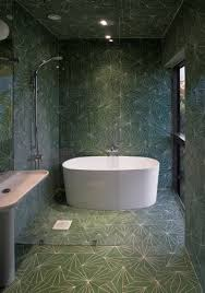 bathroom tile idea use the same tile on the floors and the walls not