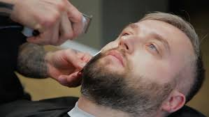 men s hairstyling and haircutting in a barber shop or hair salon man hairdresser doing haircut
