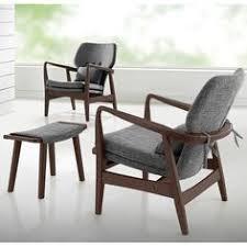 dobra mid century modern grey fabric upholstered club chair with sleek polished wood arms in walnut finishing by baxton studio baxton studio lounge chair