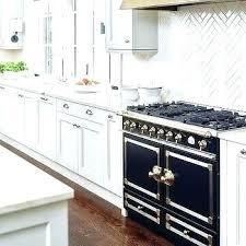white herringbone backsplash white herringbone tile cabinets glass