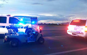 this photo provided by the arizona department of public safety shows police vehicles that stopped a golf cart traveling westbound on eastbound highway in