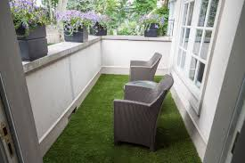 have a beautiful balcony with artificial turf