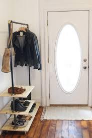 ultimate roundup of apartment friendly diys industrial shoe and coat rack