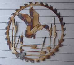 duck circular sawblade heat colored metal art wall by tibi291
