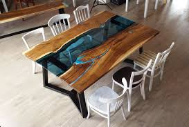 dining table with glass and glowing turquoise pigment bench is glowing too
