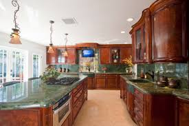 kitchen design entertaining includes: the new kitchen includes a large island perfectly suited for entertaining guests double ovens and dual oversized stone sinks to handle the prep and cooking