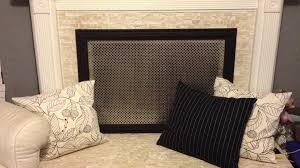 diy decorative fireplace screen drop a perforated aluminum sheet i got mine from home depot into a picture frame hot glue where the metal meets the