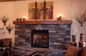 impressive cultured stone with wood mantel