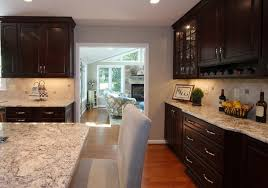 impressive kithen plan with white springs granite countertop and chocolate brown oak kitchen cabinet