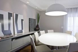 good looking minimalist dining room ideas for apartments with white round dining table feat dining chairs also dining lamp and grey cabinet storage