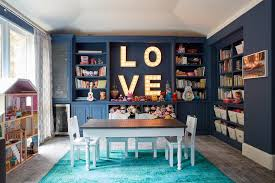 blue playroom with teal overdyed rug