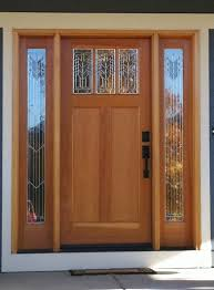 pretty light oak front door with double side lights plus decorative glass panels and black handle on white frame