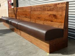 long wood dining bench. long brown wooden dining bench with dark leather seat plus back placed on wood