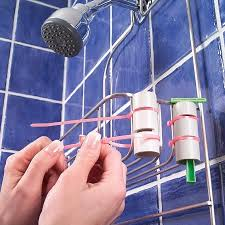 DIY a razor holster and attach it to your shower caddy