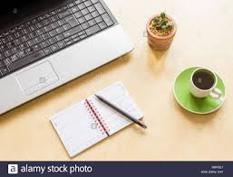 running home office. High-angle Shot Of A Home Office Desk Space With Laptop, Cactus Plant, Running S
