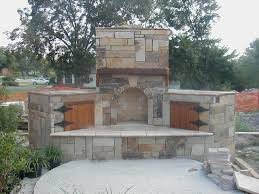 nice outdoor stone fireplace between logponds and amusing view around plus usual floor model