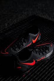 black and red nike athletic shoe photo ...
