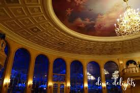this magnificent ballroom has high domed ceiling chandeliers and snow laced gothic arches look closely and you will notice snow gently falling outside of