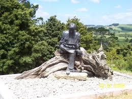garden bronze boy with plane man reading newspaper statue