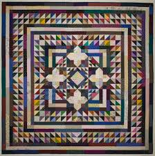 """Medallion Quilt """"Tied Together"""" – Lynn Roddy Brown on Scrap Quilting & In the picture below you can see me playing on my design wall. There are  blocks that I thought I might use but didn't seem to work. Adamdwight.com"""