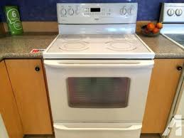 kenmore glass top stoves triple task white smooth top range stove oven