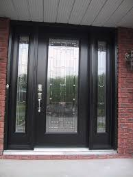 black wooden door with glass on the middle plus narrow glass windows with black wooden frame