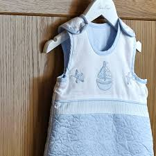 shoulder poppers and zips allow easy access to baby the vintage blue