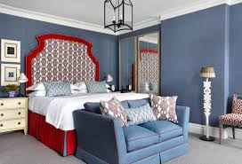 Elegant A Large Spacious Bedroom With Blue Walls And A Patterned Headboard In A Red  And White