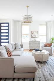 light gray sectional with cowhide tile rug