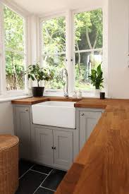 light grey cabinets and stained butcher block countertops