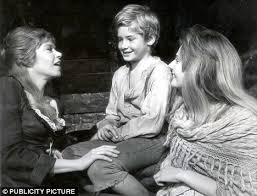 the bloody killing of the real life nancy that so obsessed charles  singing and dancing star shani sings one of the hit numbers oliver played by mark lester and bet played by sheila white
