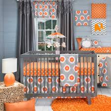 gray wooden crib with bars on the side board combined with gray orange bedding set also short legs