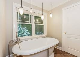 master bathroom with nickel beehive pendant lighting
