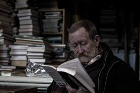 Image result for guy reading a story