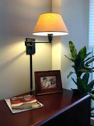 wall mount plug in lamp breathtaking corner sconce plug in swing arm wall lamp wall lamp and picture and gray wall and wooden table and books and vase with