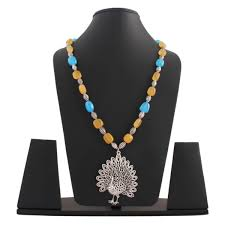 beautifully crafted german silver peacock pendant necklace chain with yellow bluw stones