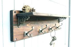 metal and wood wall shelves shelf with hooks wall shelves image of wood wooden pegs peg