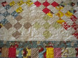 Learn Helpful Tips for Setting Quilt Blocks On Point & View of Colorful Quilt with Diamond Pattern Adamdwight.com