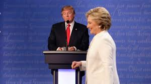 election day americans choose between clinton and trump news republican presidential nominee donald trump waits behind his podium as democratic presidential nominee hillary clinton makes her way off the stage