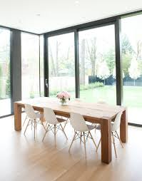 wood table white eames chairs love table chairs or family friendly kitchen dining also love how it is positioned in window nook