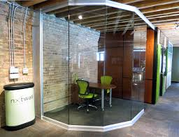 glass office wall. chicago movable wall showroom angled view glass office