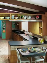 modern mid century kitchen with bits of cathrineholm orla