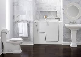 american standard walk in bathtub with whirlpool jet massage. an outward opening door is now available on american standard walk-in bathtubs in soaking tub, air bath, whirlpool and combo massage models. walk bathtub with jet e