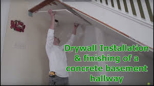 drywall installation finishing of a concrete basement hallway by home painters toronto