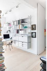 home office design ltd. Modern White Home Office Design Featuring A Wall-mounted Shelving And Storage Solution - Workspace Ideas \u0026 Decor Ltd R