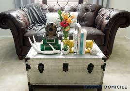 Vintage trunk coffee table Upcycle View In Gallery Bright Silver Metal Trunk With Lots Of Accessories Wayfair 16 Old Trunks Turned Coffee Tables That Bring Extra Storage And