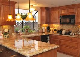 paint color to match honey oak cabinets. oak cabinets with saratoga style doors and drawers. golden crystal granite full height grantie paint color to match honey