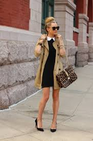 a lightweight trench is worn atop white collar black dress completed with cute black pointed toe pumps