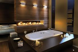 Contemporary master bathroom with fireplace and drop-in bath tub.Source:  Zillow Digs